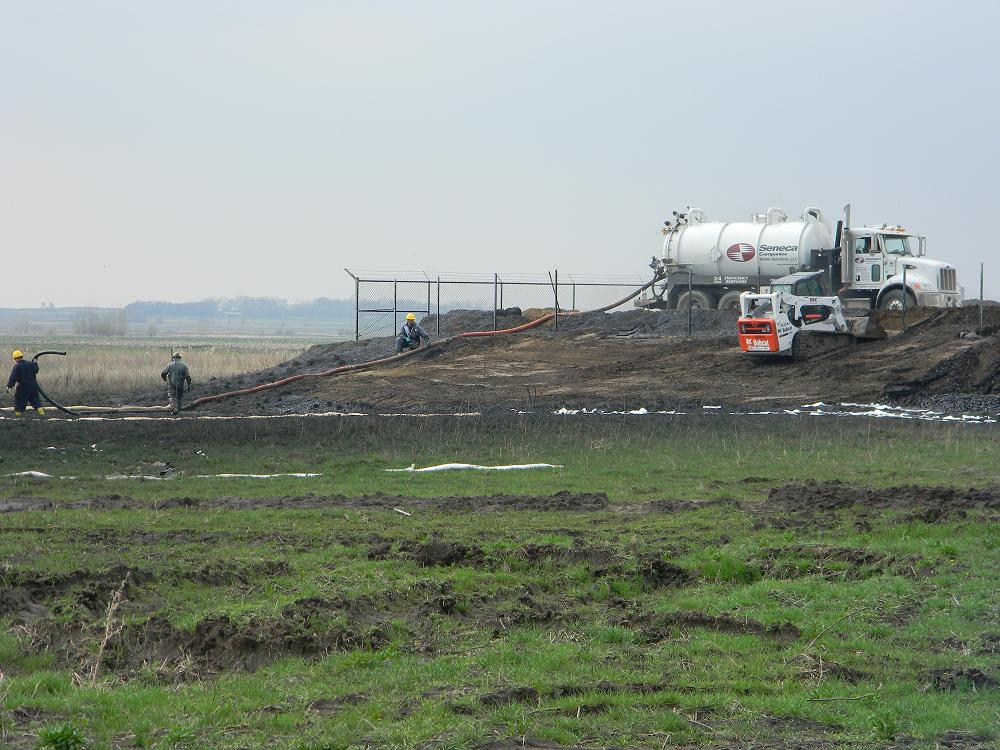 Workers clean up oil spilled outside Ludden Pumping Station, TransCanada Keystone tar sands pipeline, Sargent County, North Dakota, May 9, 2011   Photo by Pete Carrels