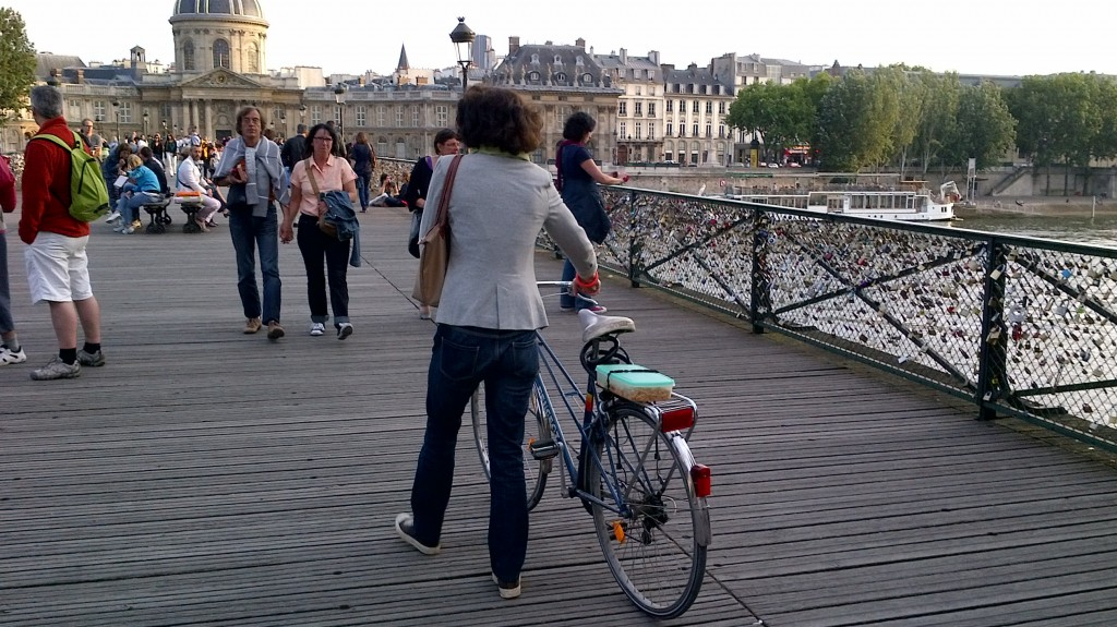 Cyclist on Pont des Arts, Paris, July 21, 2012