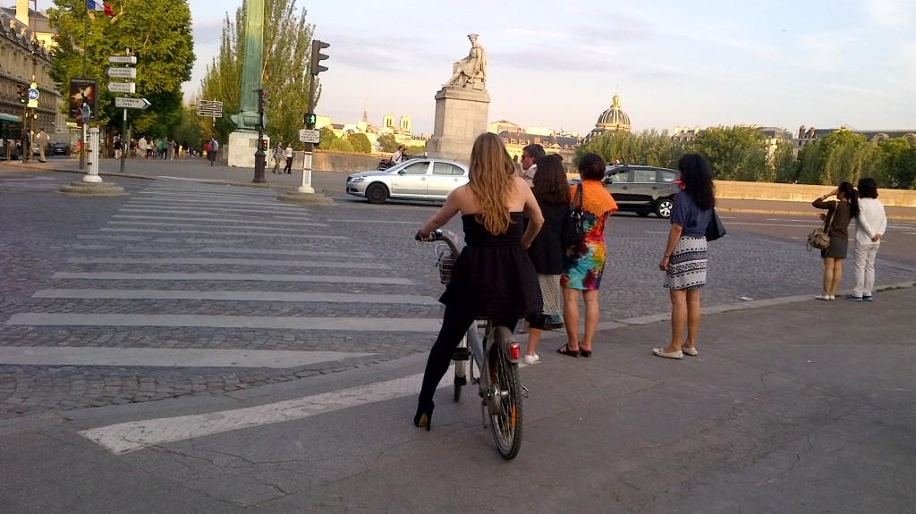 Cyclist at Pont du Carrousel