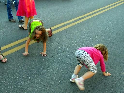 Children dance on Main Street