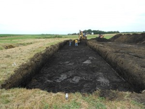 Excavation for woodchip bioreactor. Photo by SDSU Extension, 2013.