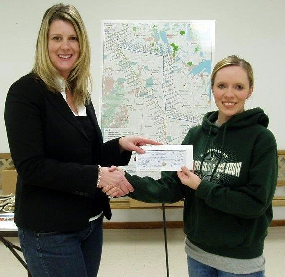 Kirsten Torgerson (L), TransCanada Stakeholder Relations, presents a $500 donation to Harding County FFA advisor Jamie Brown, early 2011.