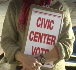 """Petitioner Pro Tip #8: Paste your issue in big letters on the back of your clipboard! Excellent idea, Don! (Screen cap from Jack Caudill, """"Organizer Says Civic Center Petition Drive off to Good Start,"""" KEVN, 2014.12.11.)"""