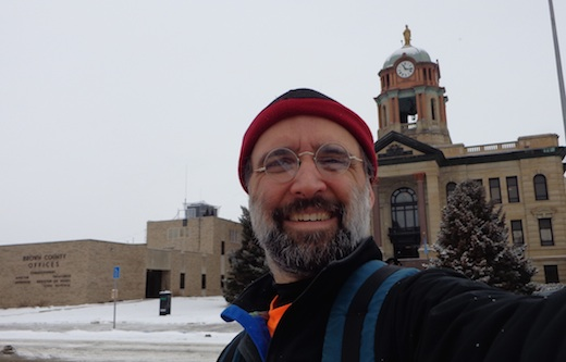 Cory Allen Heidelberger, editor-in-chief of the Madville Times, in front of the Brown County Courthouse, in his new home city of Aberdeen, South Dakota. 2015.02.03