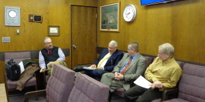 I think we need to talk out in the hall—New Angus CEO Doug Cooper (far left) and executive chairman Keith DeHaan (far right) consider what they'll say on the record to Brown County Commission on their effort to resurrect the former Northern Beef Packers processing plant in Aberdeen, SD, 2015.02.17.